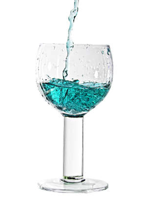 Splash in a glass. A fresh cold drink. Colorful drink. Stock Photo