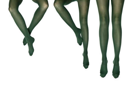 female legs in colorful tights, legs on the white background.