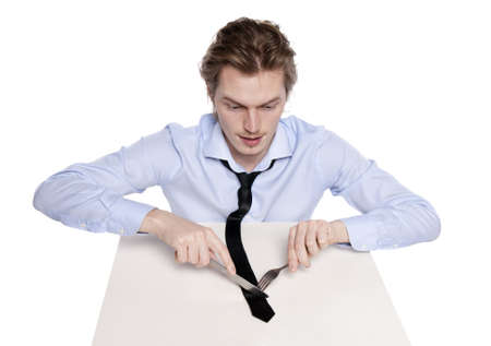 Young man eats his necktie. Studio shot of hungry man, isolated on white. Stock Photo