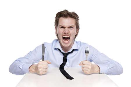 hambriento: Joven tiene hambre. Disparo de estudio del hombre hambriento, aislado en blanco.