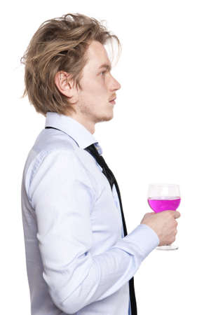 Young man holding a glass of pink wine. Studio photo of blonde man on white background.