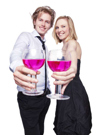 Young couple toasting with pink drink. Selective Focus.