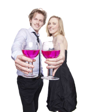 Young couple toasting with pink drink. Selective Focus.  photo