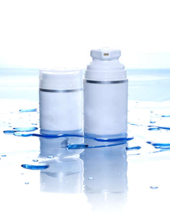 generic medicine: Two blank cosmetics containers and water. A lot of copy space.  Stock Photo
