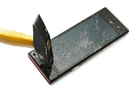 broken telephone: New smart phone smashed by a good hammer.  Studio photo, isolated on white.