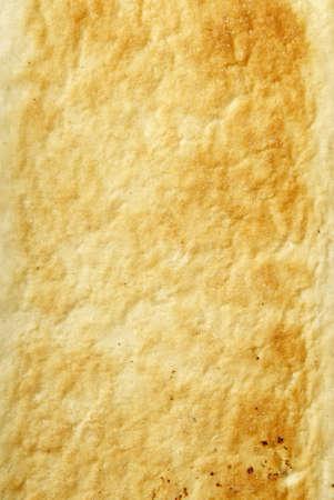 Studio photo of part of bread, bread background. Macro. Textured.