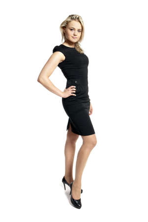 Portrait of attractive young woman in a black dress looking at camera.