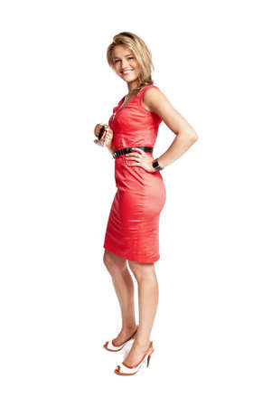 Attractive young woman in a red dress smiling and looking at camera.