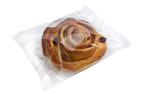 A studio photo of fresh bread in transparent plastic folie on a white background.