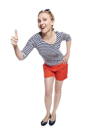 Studio shot of a young woman showing thumbs up  photo
