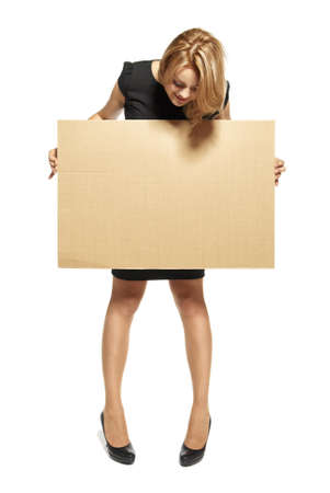 Attractive  Young Woman Holding Up a Blank Paperboard  Studio shot of woman isolated on white background