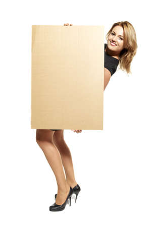 Attractive  Young Woman Holding Up a Blank Paperboard  Studio shot of woman isolated on white background Stock Photo - 14679855