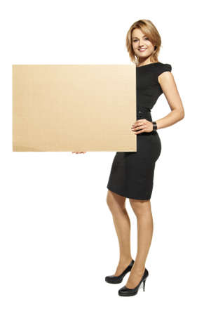 Attractive  Young Woman Holding Up a Blank Paperboard  Studio shot of woman isolated on white background Stock Photo - 14679856