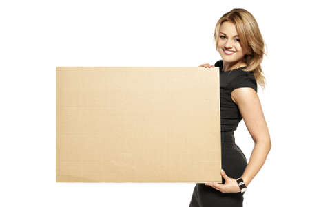 Attractive  Young Woman Holding Up a Blank Paperboard  Studio shot of woman isolated on white background Stock Photo - 14679860