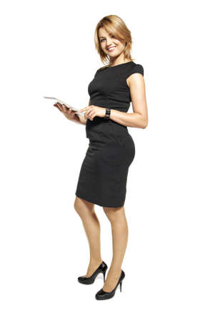 Studio shot of attractive  woman in a black dress  Portrait of office worker isolated on white background  photo