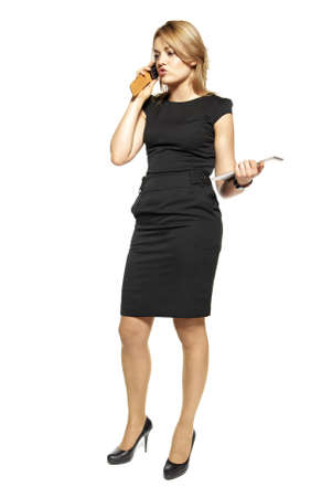 Stuido shot of attractive  woman in a black dress  Woman talking on the phone  photo