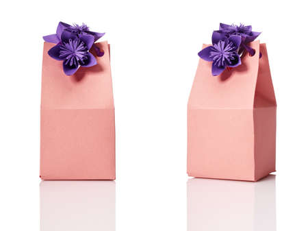 Studio shot of small gift box with decoration. Box isolated on white background.