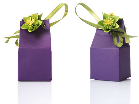 Studio shot of small gift box with decoration. Box isolated on white background. photo