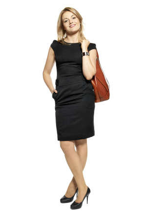 Studio shot of attractive  woman in a black dress with a bag  Portrait of businesswoman isolated on white background  Stock Photo
