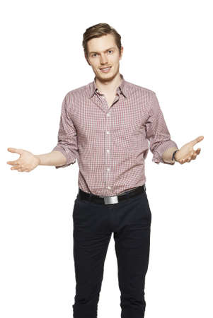 Young man throws up his hands. Studio shot of young man against a white background.