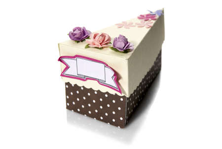Studio shot of box-shaped piece of cake  photo