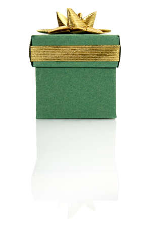 Studio shot of green gift box with gold decoration  photo