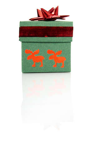 Studio shot of green gift box with red decoration  photo