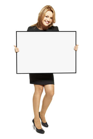 Attractive young woman holding up a poster  Isolated on white background
