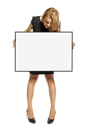 Attractive young woman holding up a poster  Isolated on white background  Stock Photo - 17958240