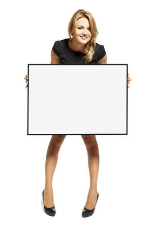 Attractive young woman holding up a poster  Isolated on white background Stock Photo - 17958241
