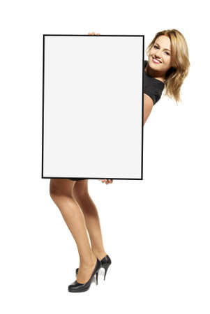 Attractive young woman holding up a poster  Isolated on white background  Stock Photo - 17958255