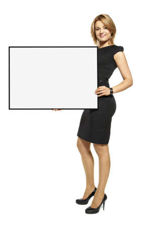 well dressed  holding: Attractive young woman holding up a poster  Isolated on white background