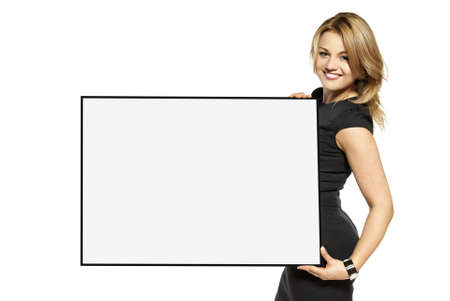 Attractive young woman holding up a poster  Isolated on white background  Stock Photo - 17958247