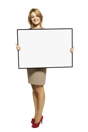 Attractive Young Woman Holding Up a Blank Sign  Studio shot of woman isolated on white background  Stock Photo - 17958239