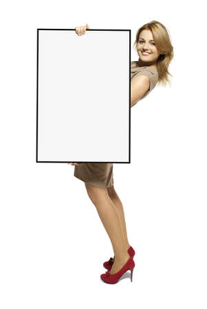 Attractive Young Woman Holding Up a Blank Sign  Studio shot of woman isolated on white background  Stock Photo - 17958257