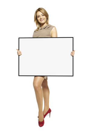 Attractive Young Woman Holding Up a Blank Sign  Studio shot of woman isolated on white background Stock Photo - 17958237
