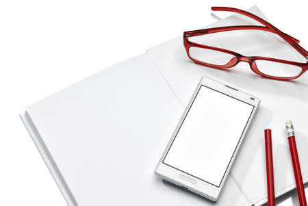 Notebook, phone and glasses isolated on white background  Copy Space  photo