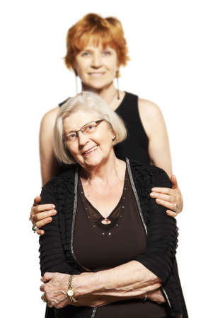 80 plus years: Studio shot of two women  Mother and Daughter