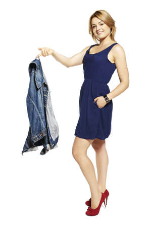 jacked: Studio shot of attractive young woman holding jeans jacked