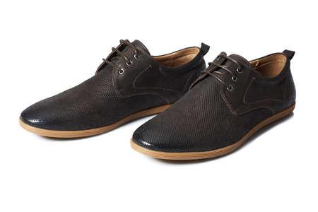 men s feet: Studio shot of brown mens shoes on white background