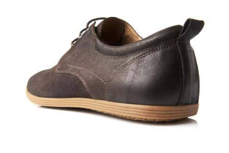 men s feet: Studio shot of brown mens shoe on white background
