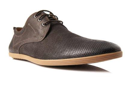 Studio shot of brown mens shoe on white background  photo