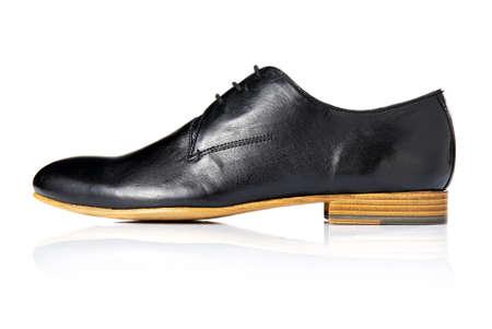 Studio shot of black shoe  Isolated on white  photo