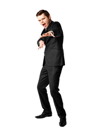 26 30 years: Young businessman dancing hip-hop against white background  Stock Photo