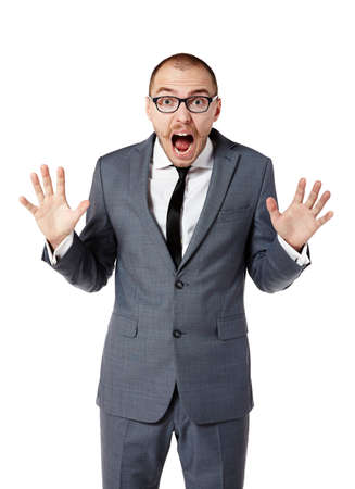 30 years old: Scared businessman with eyes wide open. Man gesturing with hands. Isolated on white. Stock Photo