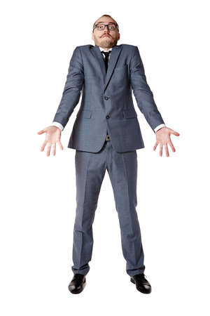 30 years old: Youth businessman spreads his arms in bafflement. Man gesturing with hands. Stock Photo