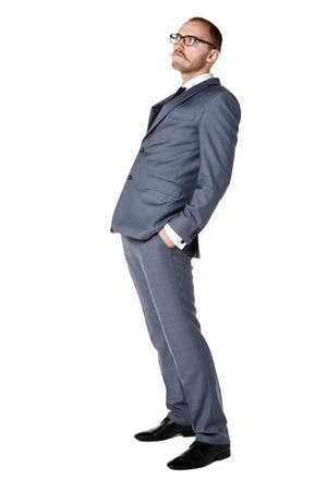 30 years old: Studio shot of cocky businessman. Isolated on white. Copy space.