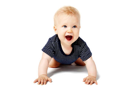 Happy baby girl is crawling on her knees. Isolated on white background. Stock Photo
