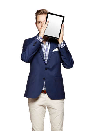 digital tablet: Portrait of a cheerful young businessman holding a blank digital tablet.
