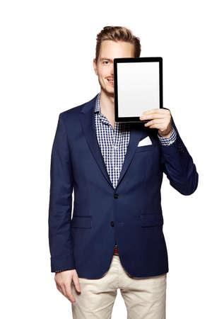 Portrait of a cheerful young businessman holding a blank digital tablet. photo